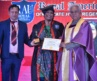 Anusha Srinivasan Iyer recieves an honorary doctorate at the hands of Madhu Krishan and Pawan Kumar Bhoot